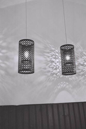 black and white picture of some cool lampshades