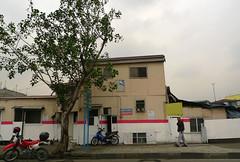 metro gwapo MMDA houses- facade covering up shanties