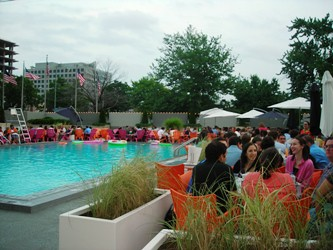 Young professionals chill by the pool at Capitol Skyline Hotel as part of Trivia Under the Stars / photo taken by Rachel Mauro