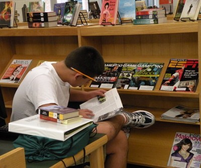 9th Grader Browsing the New Magazines!