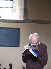 Stephen studies the extensive book about St Mary & All Saints, Dunsfold