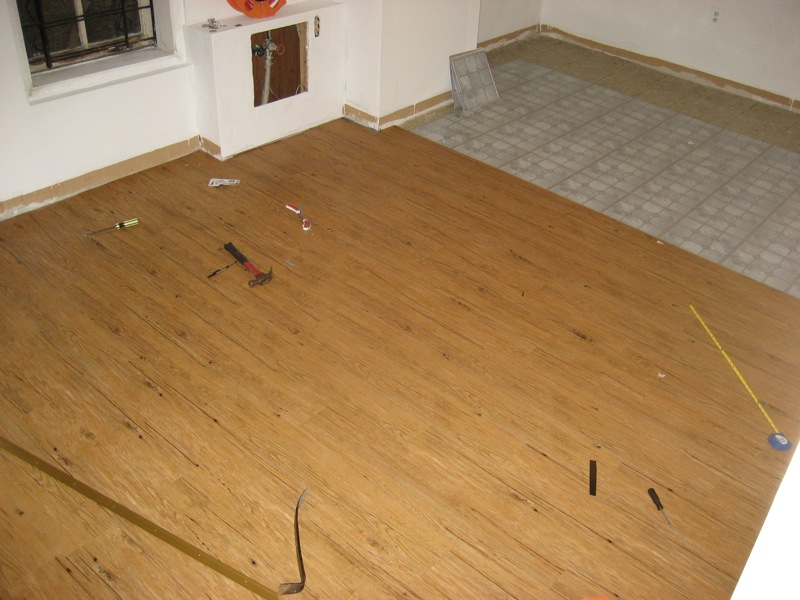 Take heed, that is not wood or laminate wood floor but the inexpensive, resilient cousin, vinyl!
