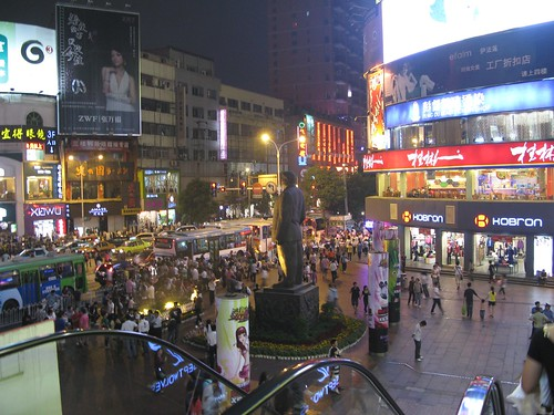 Walking Street is behinde the statue, to the right.