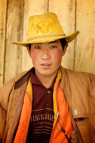 A Tibetan man stops to pose for a portrait in Litang, China.