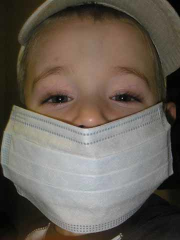 at the doctors, wearing his mask
