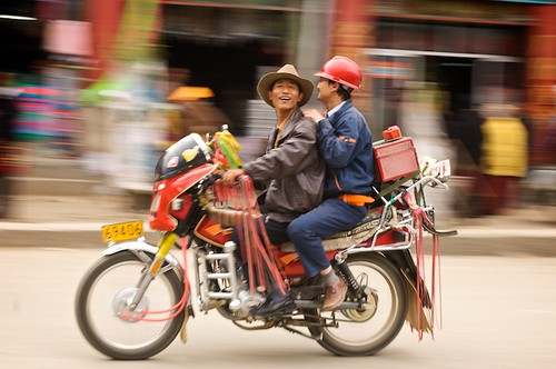 """Litang was the only area that I noticed the locals decorating their motorcycle so fancily.  Farmers, town-folk, and even monks hang streamers and bright decorations on every conceivable place on their bikes.  (Yes, I though of making a """"Village People"""" comment, but resisted)"""