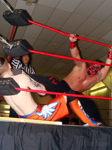 HVW Livewire Champion Kahagas puts the boots to Gary Jay in their title match. Photo by Kari Williams