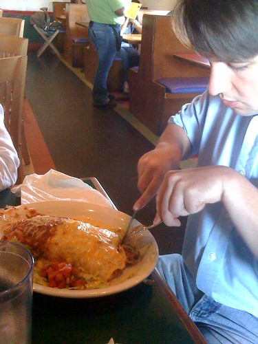 Allen eating a Texas Burrito at Montereys yesterday.  NOMZ.