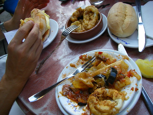 Tumbet (traditional Mallorcan dish with potatoes, eggplant, and peppers sauteed in olive oil and garlic) and squid - Palma