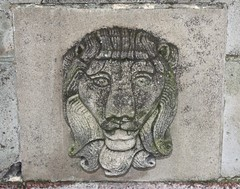 Lion head relief on south-facing side of Coulson Memorial.