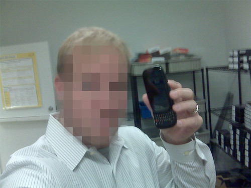 BestBuy store employee photgraphed with Palm pre demo unit
