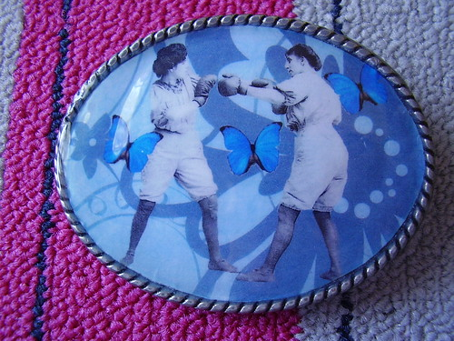 """The trouble with the women's movement"" belt buckle"