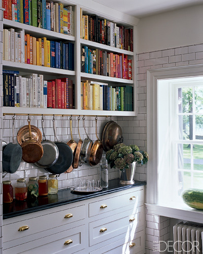 Kitchen with potrack and bookshelves