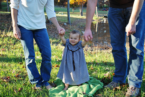 Edda, standing with mommy and daddy