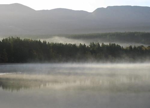 Early morning mist lifts off Loch Morlich