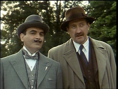 Poirot and Inspector Japp after another solved...
