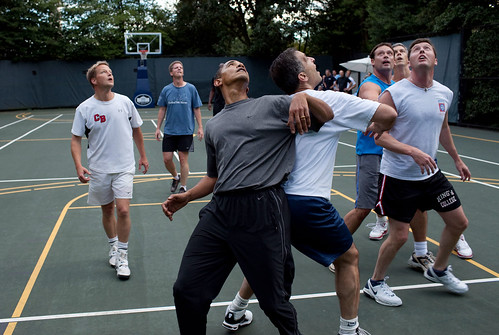 President Barack Obama, along with members of Congress and Cabinet secretaries, jockeys for a rebound during a basketball game on the White House court, Oct. 8, 2009. (Official White House Photo by Pete Souza)