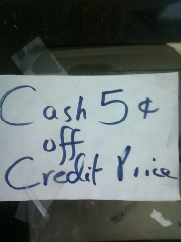If the price of gas is cheaper using cash, the...