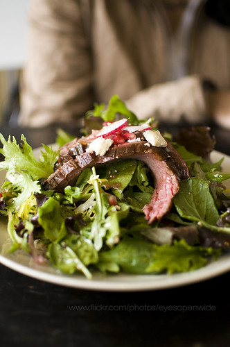 flank steak salad with pomegranate and cheese