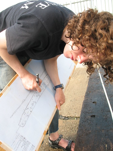 Sarah measuring and drawing the planks of the FPL 77 wreck