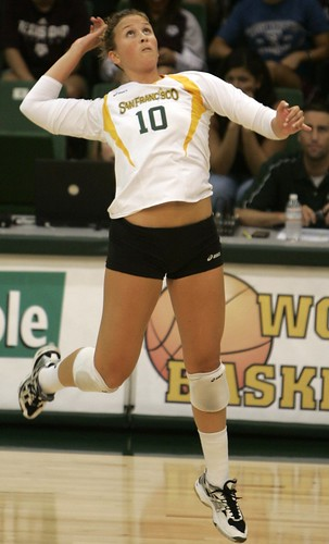 Senior Anna Berger prepares to slam the ball. As a student-athlete and volleyball team captain, Berger is a leader on and off the court.  Photo Courtesy of USF Athletic Department