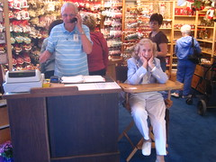 Connie likes the action, a lull in the crowd leaves her bored. Bob was busy giving a customer rep for American Express the what for because he was not able to take their cards like he was supposed to.