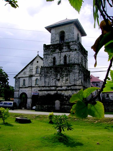 The mission of Baclayon was established by two Jesuits Juan de Torres and Gabriel Sanchez who arrived in Bohol on 17 November 1596. They came from Cebu. Torres reports that he could not find a decent place to celebrate Mass, there wasnt even a servicable table in the dwelling they stayed in. The Jesuit convinced the inhabitants to build a church, which they accomplished in no time. This was most likely a bamboo and thatch church.  Baclayon served at one time as the residentia or center of the Bohol missions, where the superior resided. Baclayon was one of two towns that did not join the Diwata revolt (1621), remaining steadfast in the Christian faith.  Despite claims that the present stone church in Baclayon is the oldest in the Philippines, evidence places the construction of the church to 1727. The belief that the church was built in 1595 may have come because of a 19th century report by the Recollects that the mission was founded in 1595; but the same report lists two other dates 1593 and 1594. The date 1595 inscribed on the church façade is a later addition.  The adjoining but separate tower may have been started by the Jesuits, but it was completed during the administration of the Recollects, ca. 1777 as a stone inscription on the tower indicates. The inscription was recently defaced. The church complex was fortified with a wall built by the Jesuits. The walls coral stones were used by the Recollects when they built a new wing of the convento in 1872.