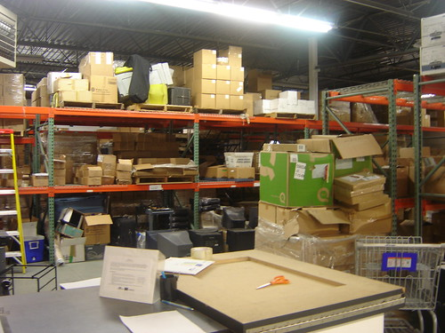 Now lets take a quick peek into our warehouse. Not very tidy, but it definitely serves its purpose. In addition to being a very large storage room for all departments, packages are shipped and received here.