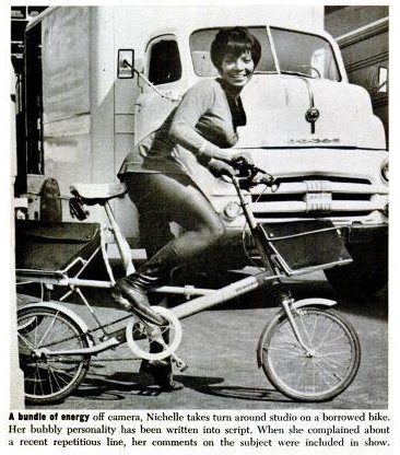 Nichelle Nichols rides a folding bicycle