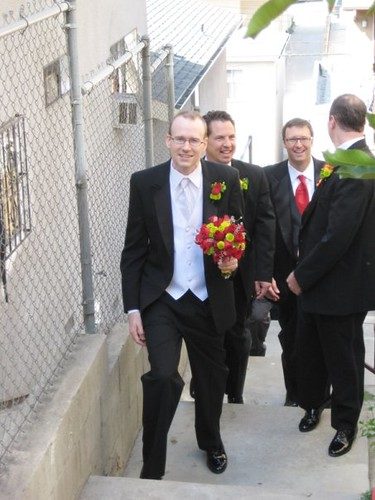 Groom and groomsmen fetching the Bride