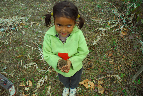girl holding dirt