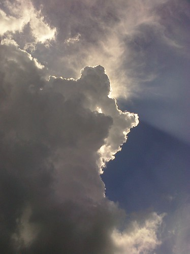 Clouds with sun peeking out by you.