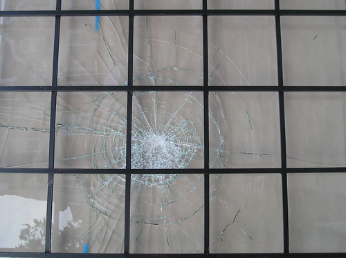 Damaged window, corner store