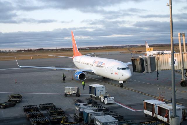 Sunwing plane arrives for boarding - Ottawa, Ontario - Punta Cana trip - 2009