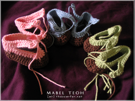 Churning out booties for the store...