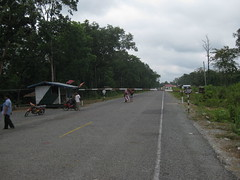 06. Once a Laos exit stamp has been obtained, one must walk this 500 meter stretch of road in neither Laos nor Cambodia