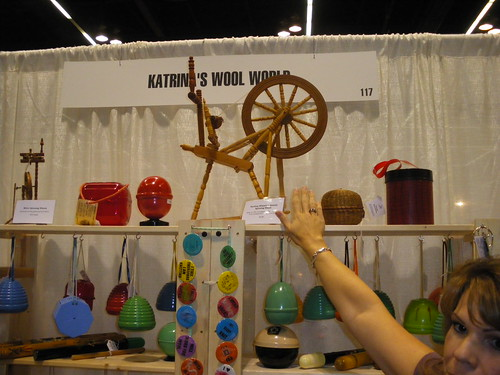 This booth has a tiny antique spinning wheel. Even more impressive is that its a fully functioning and working wheel! Kristies hand is in the photo for a size reference.