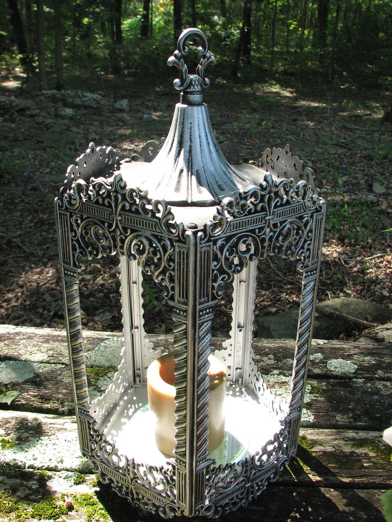 Interior view of lantern showing mirror and candle.