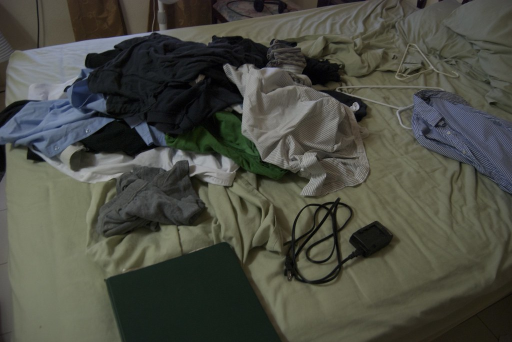 pile of clothes on my bed