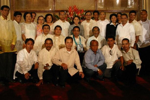 Barangay Katangawan Council Officers with (seated from left) GenSan City Mayors Office Chief of Staff Ernie Quisay, City Councilor Odjok Acharon, Barangay Captain Remy Herceda, DILG City Director Rudolfo Bernardino.