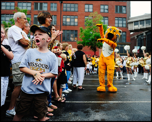 Six-year-old Liam Hampton of Springfield shouts the M-I-Z cheer during a rally in the alumni association area outside the Edward Jones Dome before the Missouri-Illinois game.