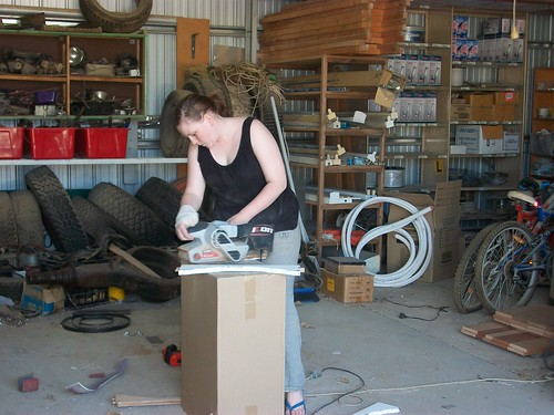 Elise sanding parts of a table