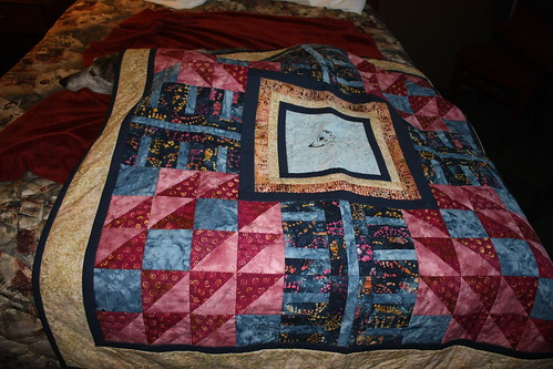 Sabrina assists in displaying the quilt