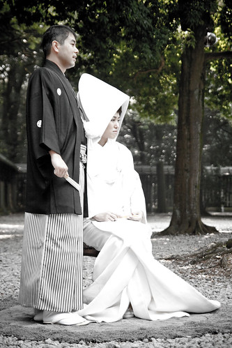 Wedding couple posing at Meijijingu