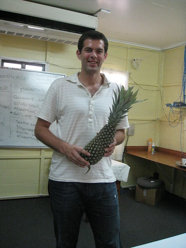 A happy chap with a pineapple