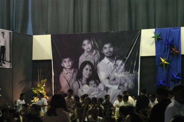 """A GIANT TARP OF THE PACQUIAO FAMILY HANGS ON THE WALL OF THE HALL"""