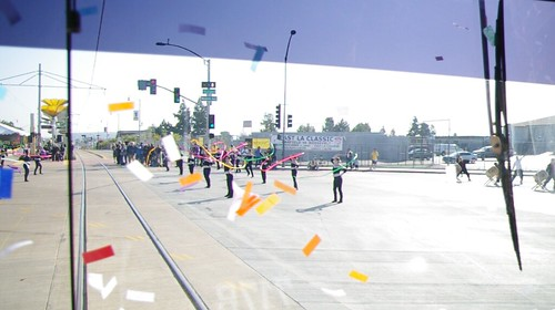 Confetti and ribbon twirlers welcome the Gold Line to the East L.A. Civic Center station.