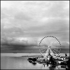 Eye of the storm (>>mansur::amir<<) Tags: blackandwhite bw storm 120 6x6 tlr film monochrome rain analog rolleiflex mediumformat square blackwhite hc110 malaysia ferriswheel kodaktmax400 melaka planar carlzeiss orangefilter 28f eyeonmalaysia rolleiflex28fplanar