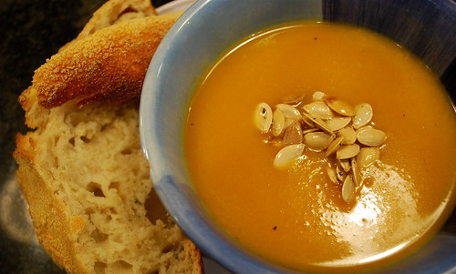 curry butternut squash soup with fresh bread & baked pumpkin seeds