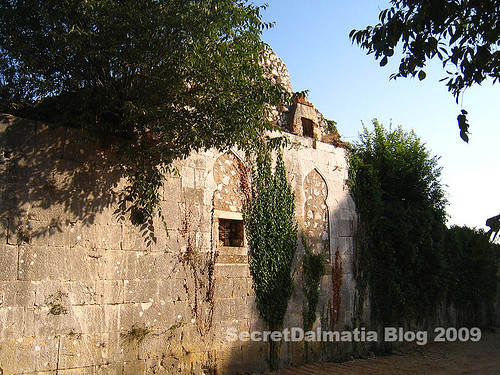 The western wall of the caravansary with beautiful oriental windows